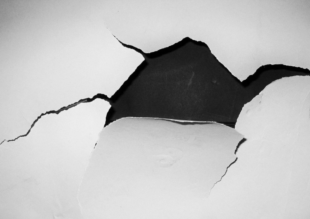 Hole in plaster wall.