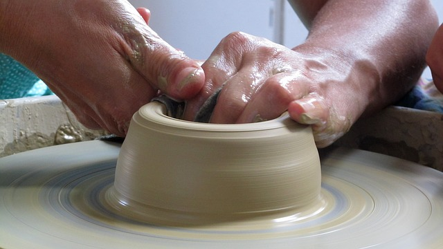Working clay on a pottery wheel