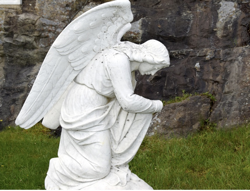 Racism: angel kneeling in prayer